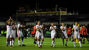 The MK Dons players salute their fans after the game.