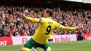 Grant Holt celebrates scoring for Norwich City at Arsenal.