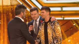 Leon Mallett shakes hands with Simon Cowell following his elimination.