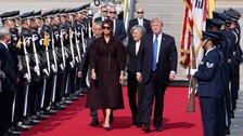 President Donald Trump and first lady Melania Trump arrive at U.S. Osan Air Base in Pyeongtaek.