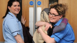 Malala gives one of the nurses at the Queen Elizabeth Hospital a hug as she is discharged