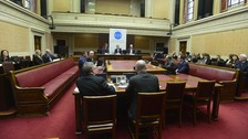 The first day of hearings takes place at Stormont.