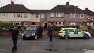 A private ambulance leaves the family home on Tuesday.