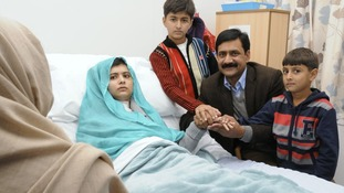 Malala Yousufzai with her father Ziauddin and her two younger brothers Khushal Khan and Atal Khanbefore in October
