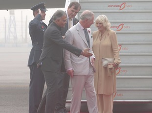 The shared a laugh as they were welcomed in the Indian capital of New Delhi.