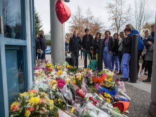 A makeshift memorial at Abbotsford Police station