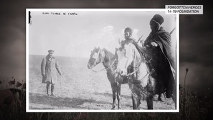 King George V (left) pays his respects to two Algerian soldiers