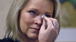 Former Boston news anchor Heather Unruh breaks down at a press conference about the sexual assault of her son.