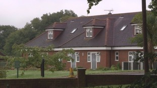 Woman held in 'neglect and fraud' probe linked to 12 care home deaths