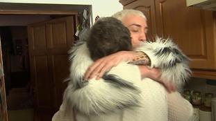 Jamie and his mum hug.