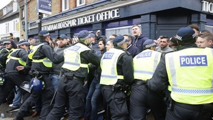 Police separate Millwall and Spurs fans.