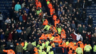 Supporters of Stoke City and West Bromwich Albion clash.