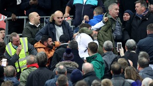 England fans fight among themselves at Wembley.