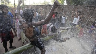 Children participating in pillow fighting competition during festivities