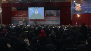 Lebanon's Hezbollah leader Hassan Nasrallah addresses crowds via video link in Beirut.