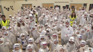 Teachers and parents joined some 250 youngsters in astronaut costume to set a new Guinness World Record.