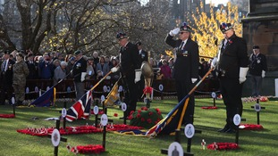 Standard bearers lower Colour Flags during a service of Remembrance at the Edinburgh Garden of Remembrance