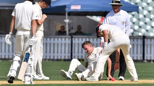 Jake Ball of England sits on the ground injured.