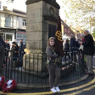 10-year-old Rosie May Ginifer carrying the flag today for 2nd Wordsley Brownies at Holy trinity church, Wordsley, near Stourbridge.