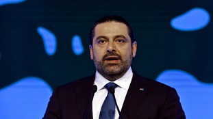 Lebanon's PM says he is not being held by Saudi Arabia and vows to return 'very soon'