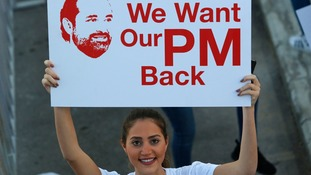 Lebanese woman calls for Mr Hariri to return from Saudi Arabia.