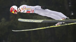 Kamil Stoch of Poland soars through the air during a trial jump 61st four-hills ski jumping tournament