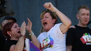 Christine Forster, the sister of former Prime Minister Tony Abbott, celebrates after watching the same sex marriage vote result.