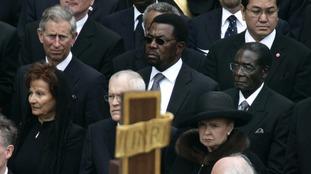 Robert Mugabe seated near Prince Charles