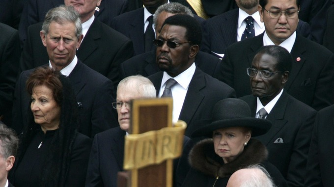 Robert Mugabe seated near Prince Charles