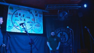 Minty unveiling the map at Clwb Ifor Bach