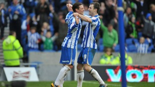 Will Hoskins is congratulated by Ashley Barnes
