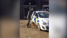 Masked man filmed smashing police car while officers attend Remembrance Sunday event