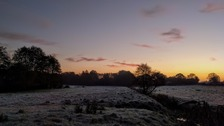 Frosty field with red sky