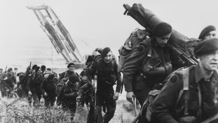 "Royal Marine commandos moving off the Normandy Beaches during the advance inland from ""Sword"" beach."