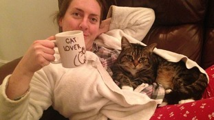 Emma Woollen, pictured with her cat Maizey.