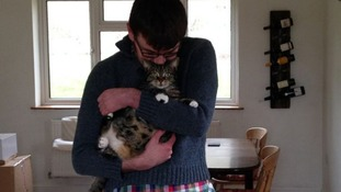 Emma's husband Peter, pictured with the couple's pet cat Maizey.