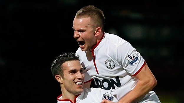 Goalscorers Robin van Persie and Tom Cleverley celebrate the late equaliser