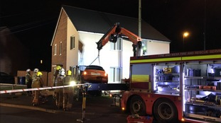 A car is removed from the side of a house in Sunderland