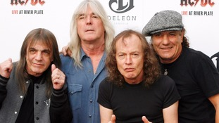 Malcolm Young (l) has died aged 64.