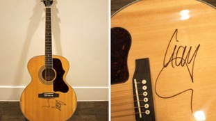 This signed guitar was stolen from a Birmingham home.
