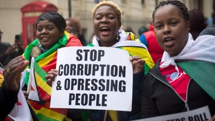 Protesters gathered outside the Zimbabwean Embassy in London in support of the ousting of Mr Mugabe.