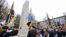 Remembrance service postponed by pipe bomb goes ahead