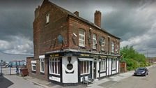 Investigation after shots fired at Salford pub