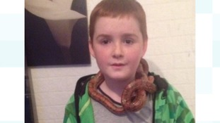 Rebecca's son Dion with Charlie the snake