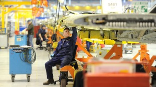 Engineers work on the wings for the Airbus A320, a Airbus UK in Broughton, North Wales.
