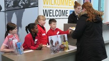 Year five students from Friars Primary School in Salford greeting guests to the museum.