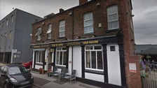 The masked men reportedly fired shots inside The Beehive pub