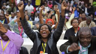Members of ZANU-PF react after a vote to fire the President was passed.