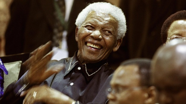 South Africa's former president Nelson Mandela gestures from the gallery at the opening of parliament in Cape Town February 11, 2010.