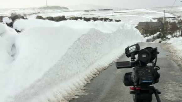 Camera in front of snow drift